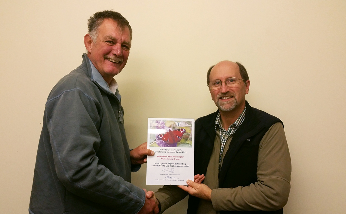 Mike Slater (left) hands over the Outstanding Volunteer Award to Keith Warmington during a Warwickshire Branch Commitee Meeting in 2015.